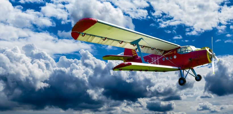 biplane over clouds red fly aircraft